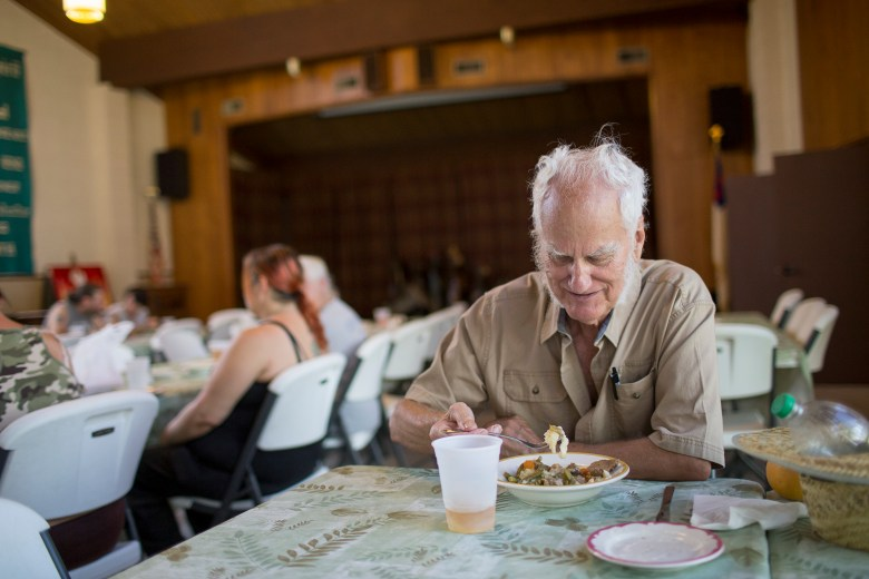 Robert Bakhaus eats lunch in Bryson City through the Giving Spoon.