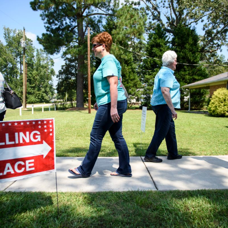 People enter and exit a polling station at the Stedman Community Building on September 10, 2019. A special election was held for voters in the 9th congressional district of North Carolina after a charges of voter fraud in the previous election. [Melissa Sue Gerrits/For Carolina Public Press]