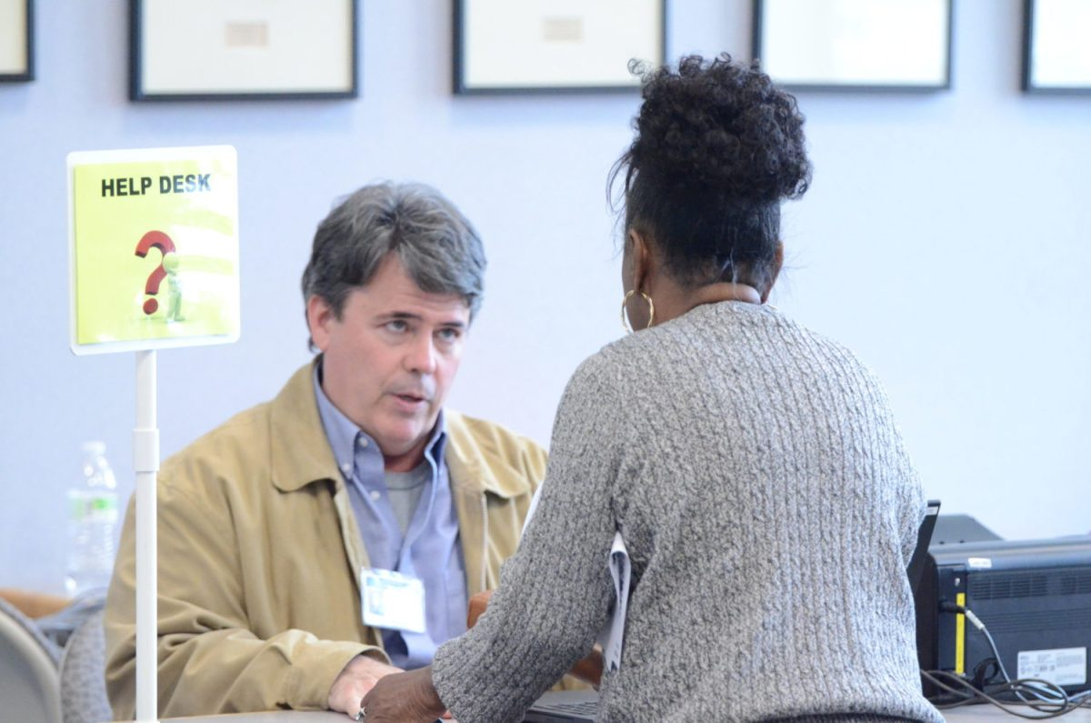 Nash County poll worker Talmin Richie gives instructions to a 2020 primary election voter at the Braswell Memorial Library polling place in Rocky Mount on March 3, 2020. Calvin Adkins / Carolina Public Press
