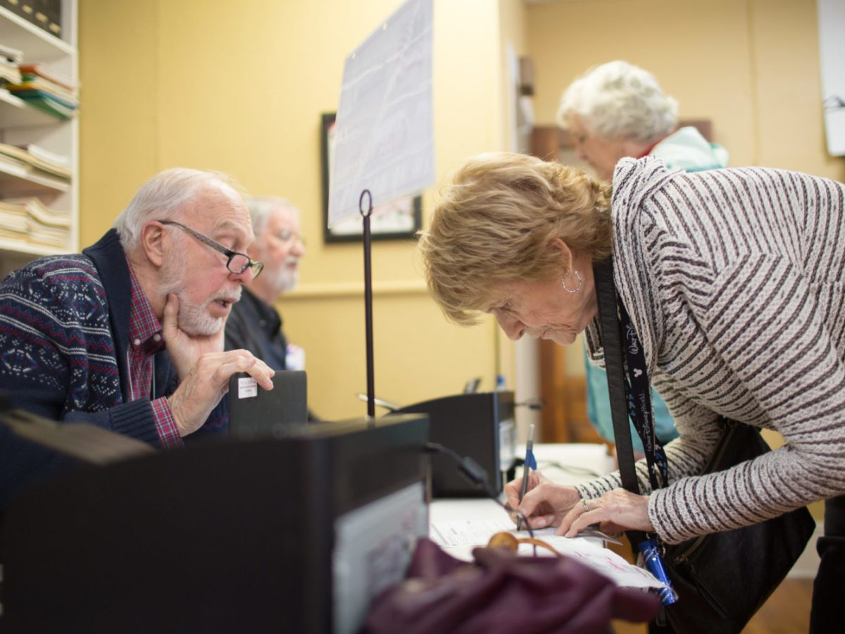 Gay Ferguson, right, speaks with election official Carter Blaisdell prior to voting at the First Baptist Church of Black Mountain polling place on March 3, 2020, in Buncombe County. Colby Rabon / Carolina Public Press