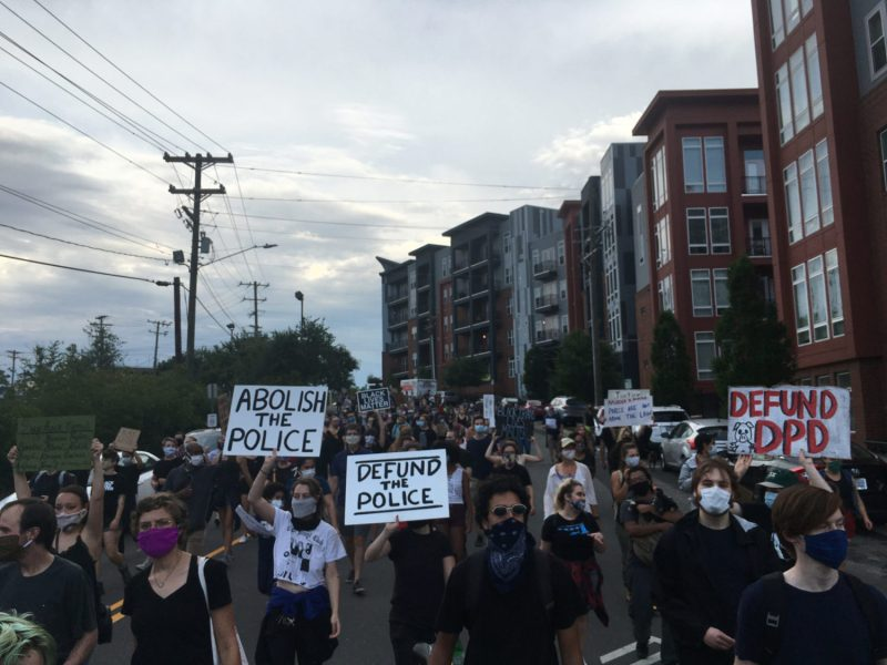 Protesters march from the Durham Police Headquarters to the Durham County Jail. Defunding police, for the organizers, also means closing the jail and other forms of law enforcement, like prisons and Immigration and Customs Enforcement.