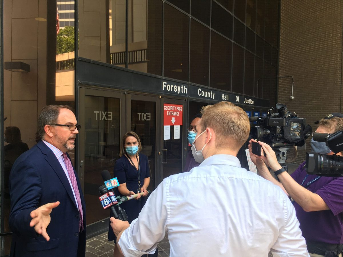 Attorney Mike Tadych interviewed by news media after Winston-Salem, NC, hearing on footage in death of John Neville, a Black man who died after injuries in Forsyth County jail.