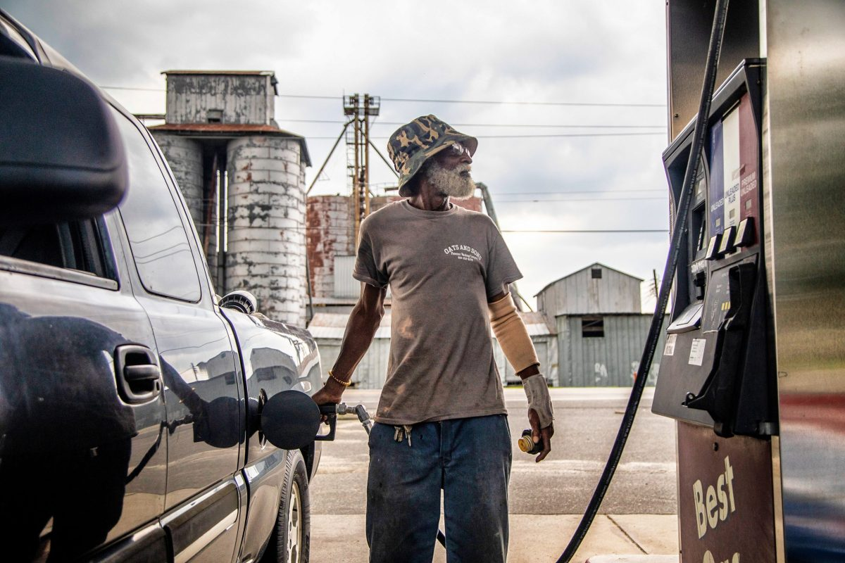 Eddie Jones of Mount Olive fuels his truck in unincorporated Dudley in Wayne County in July 2020.