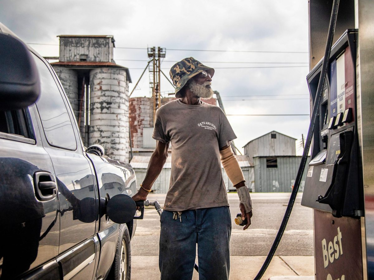 Eddie Jones of Mount Olive fuels his truck in unincorporated Dudley in Wayne County in July 2020.