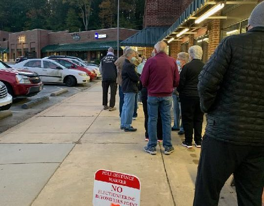 A long line of voters stretches around the Enka-Candler library in Buncombe County early Thursday morning, Oct. 15, 2020, as one-stop voting gets underway. Photo courtesy of Phyllis Taylor