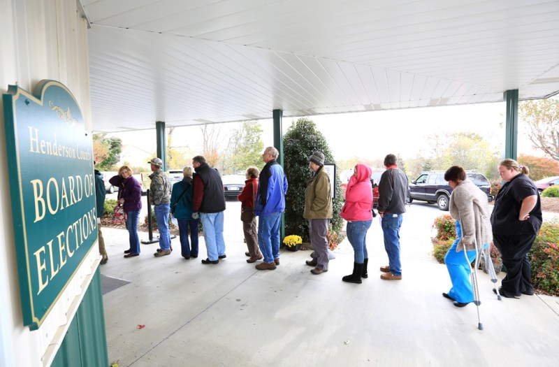The line for early voting extended out the door at the Henderson County Board of Elections on Tuesday, Oct. 30. Elections officials say there has been a steady flow of people at most polling locations in both Henderson and Buncombe counties since early voting began on Oct. 18. (Colby Rabon/Carolina Public Press)