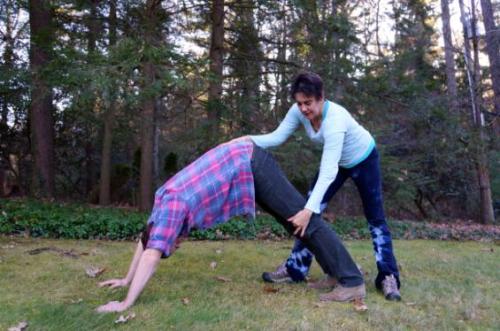 Jane Grant Helping a Yoga Student