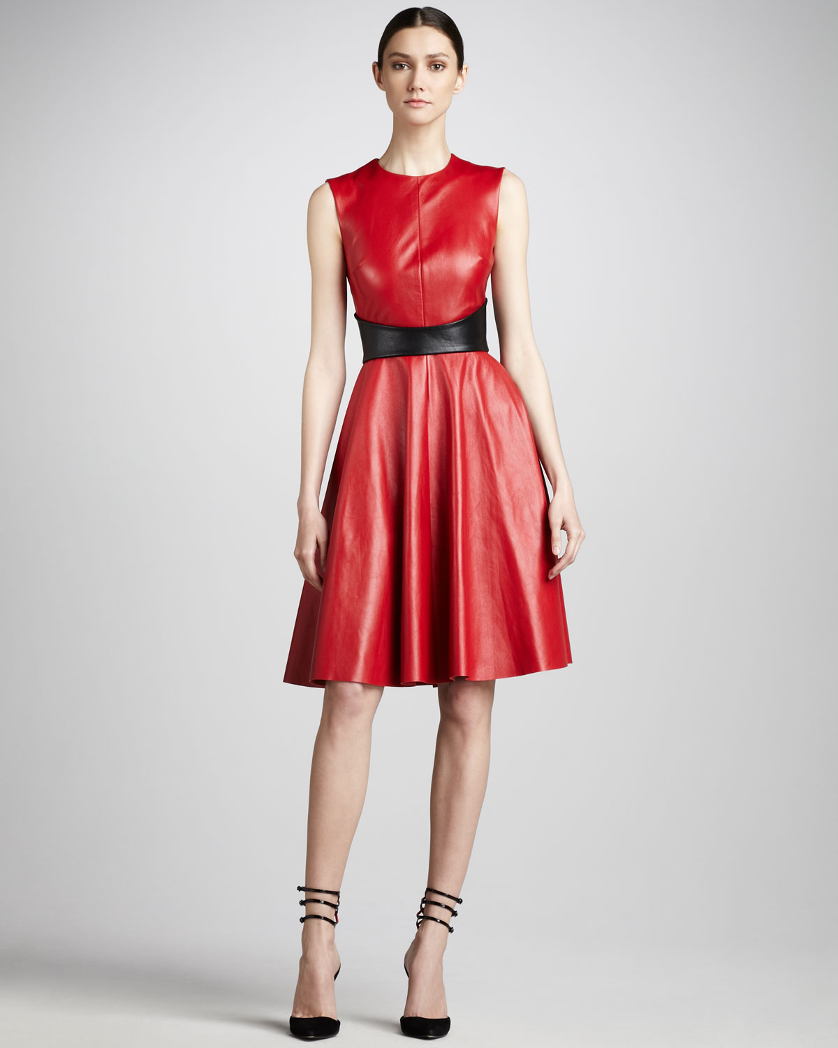 3b0b872525088 Highlighted with a black leather snap belt that flatters the waist, this  dress is striking. photo credit: polyvore.com. Alexander McQueen ...