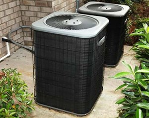 Residential Central Air Conditioning Units On Cement Slab
