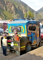 Ninos in Pisac loved playing in the mototaxi trunk.