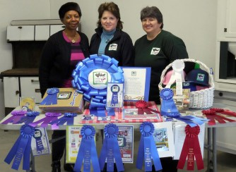 Luella McField, Francine Whittaker, and Lynda Tate show off all their awards.