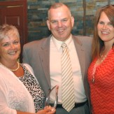 2014 award recipient, Major Scott Moser, (center) with wife Carrie (right) and chamber president, Mary Pitts.