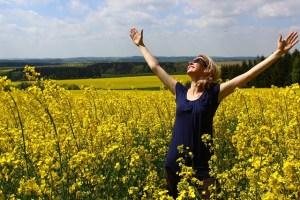 Happy in yellow flower field