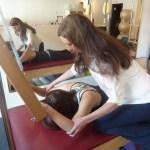 Caroline Feig, PT in a pilates session