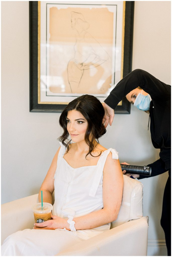bride getting hair done at Park Chateau