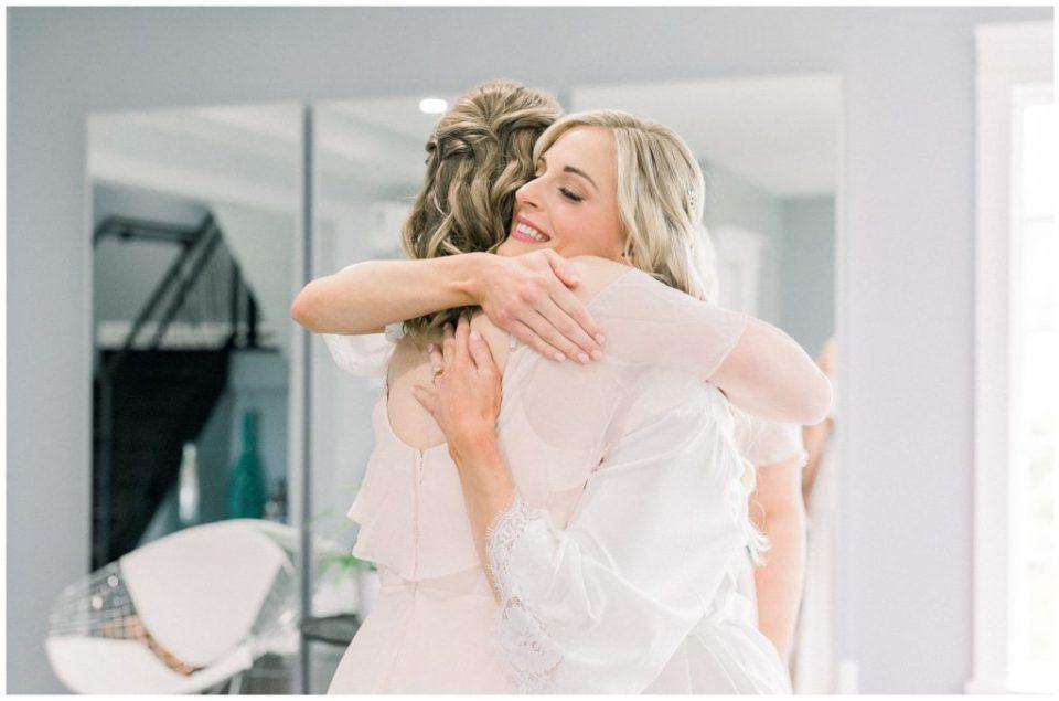 bride hugging sister at Ryland Inn wedding
