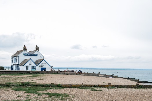 Wide shot of Whitstable's west beach and the Old Neptune pub