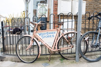 A vintage bike with Windy Corner Stores advertising in Whitstable