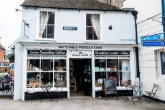 The front of Whitstable's quaint produce store, with seats outside