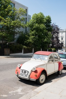Classic Citroen parked against trees in Kensington