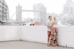 Couple cuddling with Tower Bridge