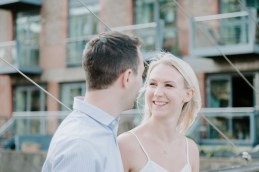 Blonde woman smiling at her fiancé in Butler's Wharf London