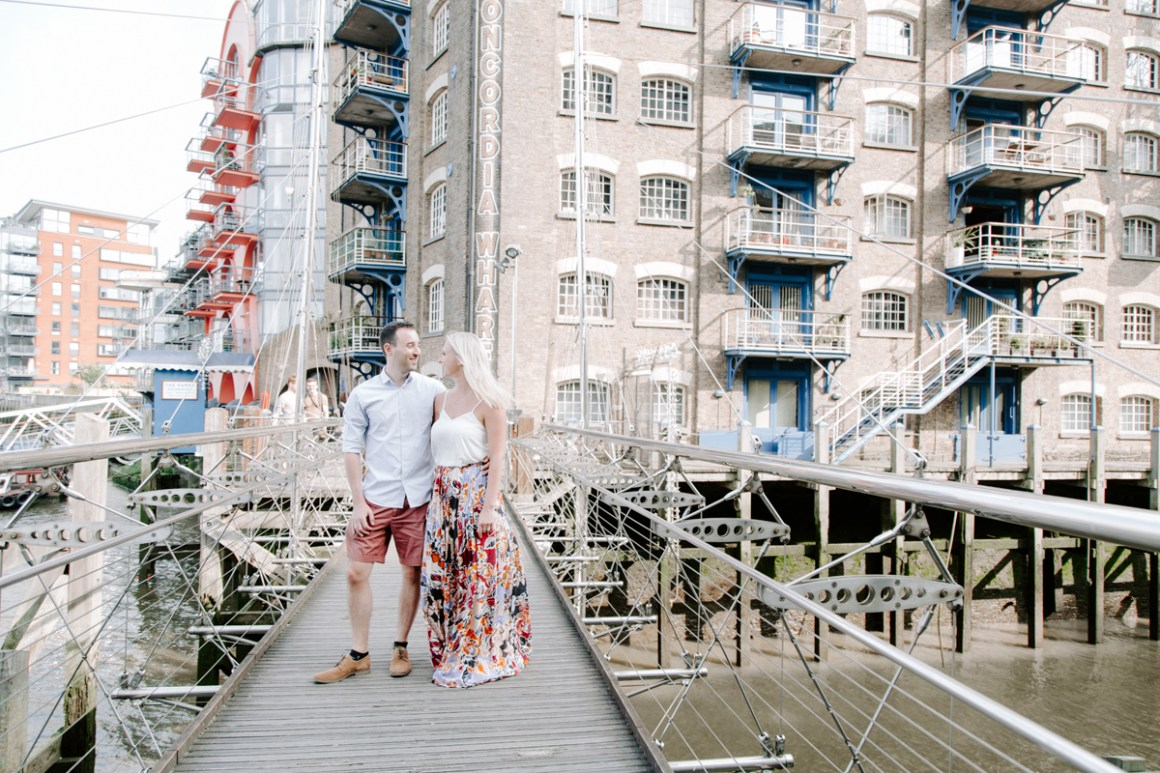 Engaged couple stood in fronton Butler's Wharf in summer