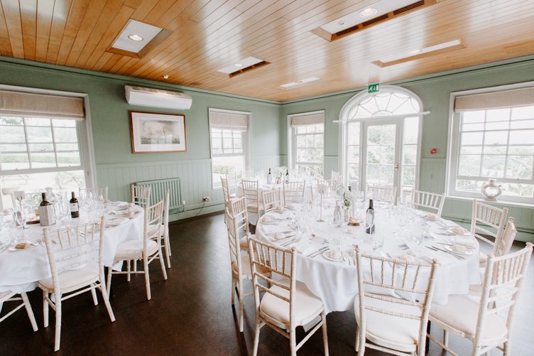 Wedding reception venue with dining tables out
