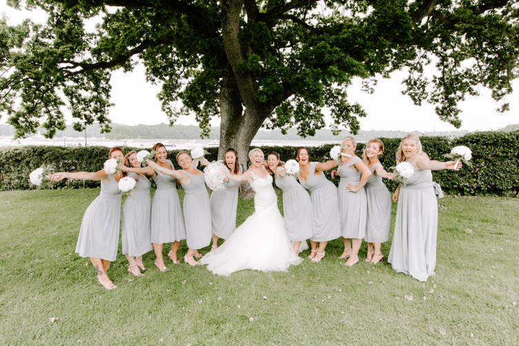 bridesmaids holding bouquets in air during group shots