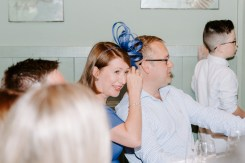 Wedding guest crying at a speech and wiping her eyes