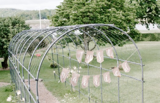 Just Married sign hanging from an iron walkway