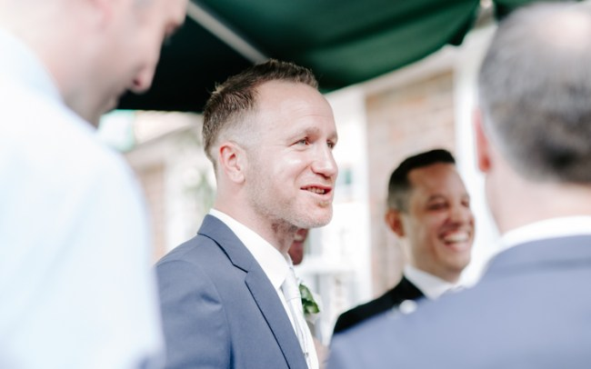 Wedding guest chatting at reception with friends
