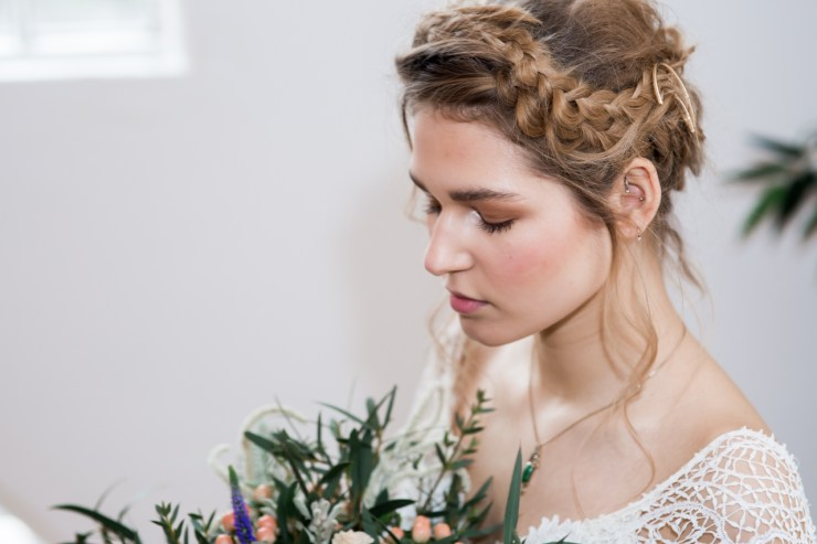 Bride wearing nude make up and with a loose boho updo