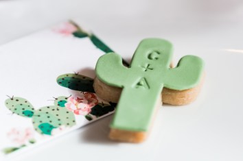 A personalised cacti shaped biscuit on cacti decorated card