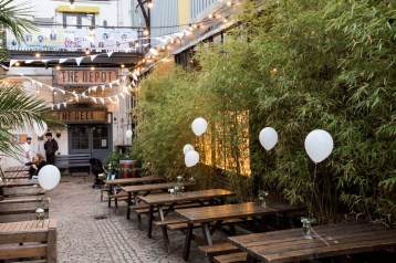 Outdoor pub courtyard with benches and bunting