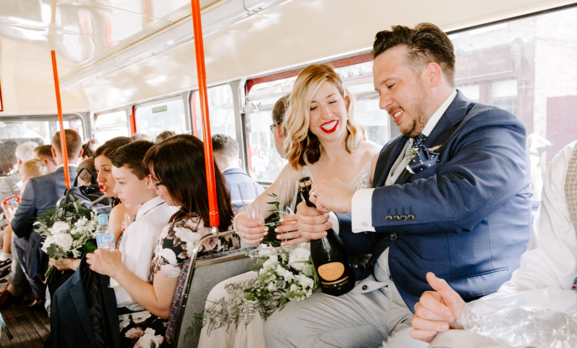 Couple on a vintage Routemaster bus at London wedding