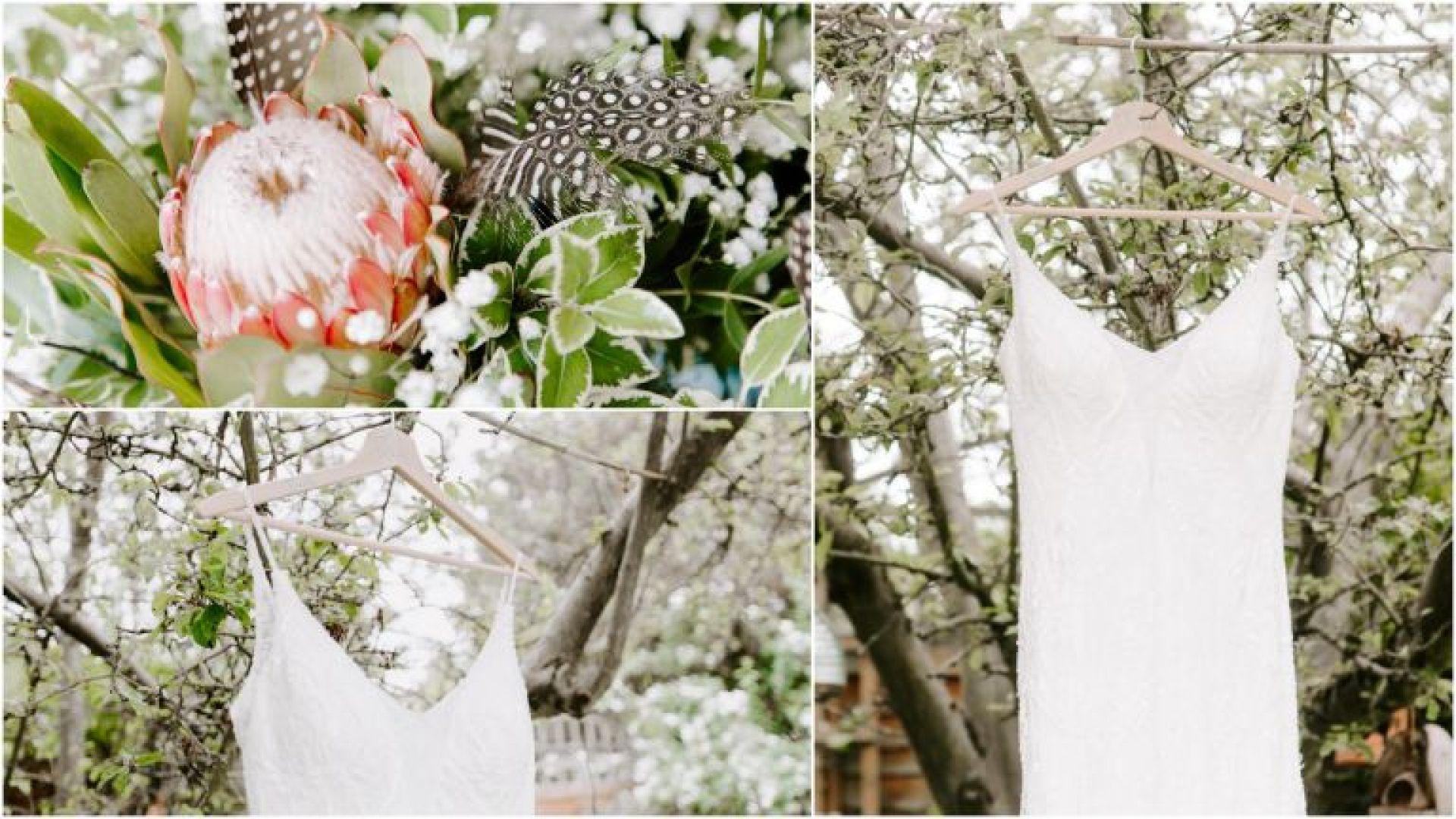 Wedding dress hanging from a treeWedding photography Hertfordshire