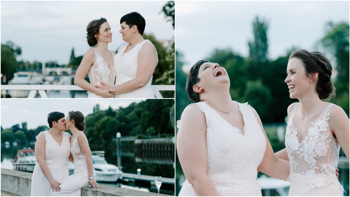 Lesbian newlyweds laughing by the Thames