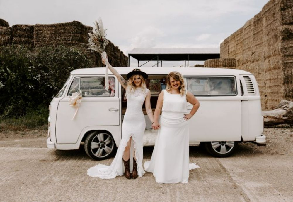 Two brides stood in front of a