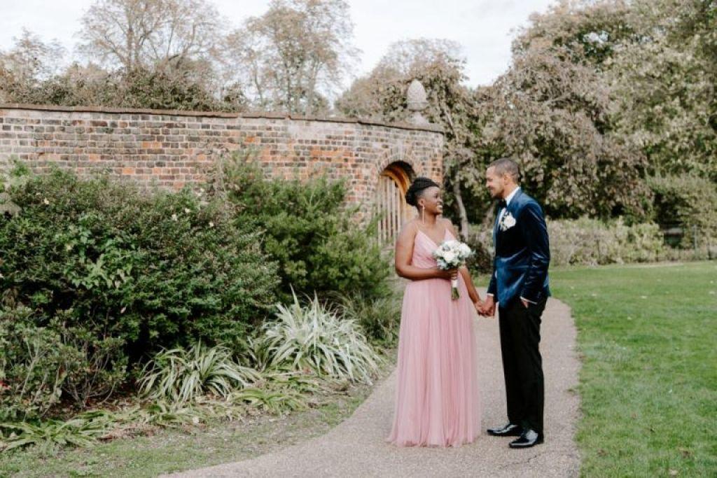 Bride and groom in the gardens of Valentines Mansion Redbridge