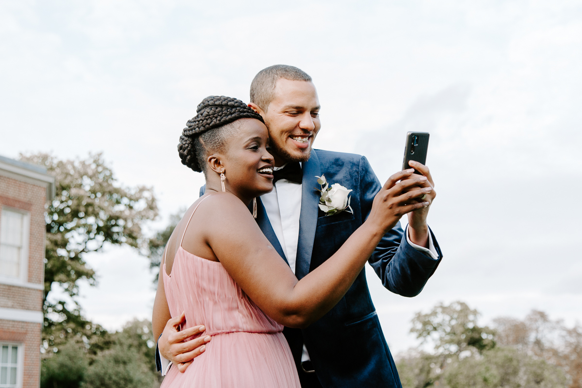 Bride and groom facetiming relatives at COVID wedding