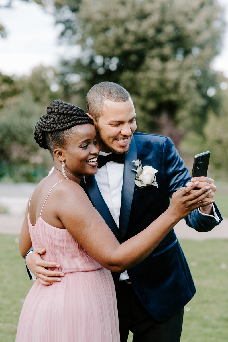 Bride and groom facetiming at COVID Wedding