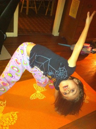 Me, doing yoga. Or trying to, anyways.