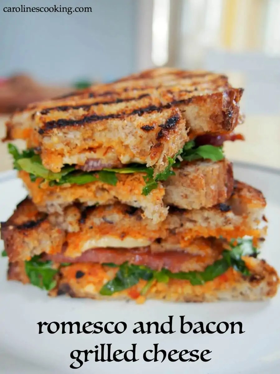 romesco and bacon grilled cheese sandwich: This delicious twist on a bacon grilled cheese sandwich uses piquant romesco sauce along with bacon, smoked cheddar and arugula to create a fantastic lunch. #grilledcheese #sandwich #bacon #romescosauce