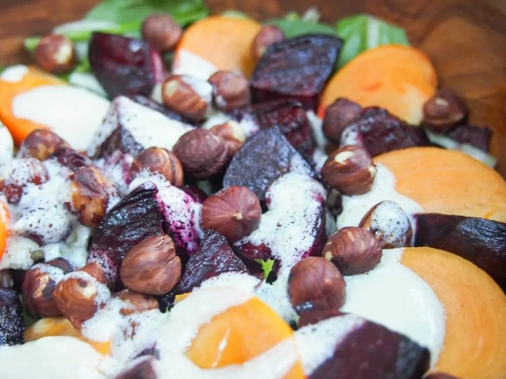 This winter beet salad has only 5 ingredients but is full of great flavors from earthy beets to fragrant persimmon, topped with a delicious creamy goats cheese dressing.