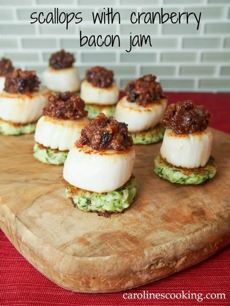 Scallops with cranberry bacon jam make for a stunning and delicious appetizer. Perfect for holiday entertaining or any excuse. via @carolinescookng