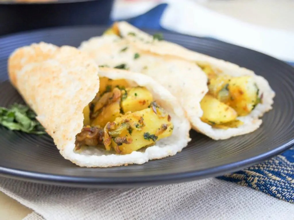 masala dosa are a traditional South Indian savory pancake with a spiced potato filling. Light and crisp, they're a delicious snack or lunch. Gluten free, vegetarian & vegan.