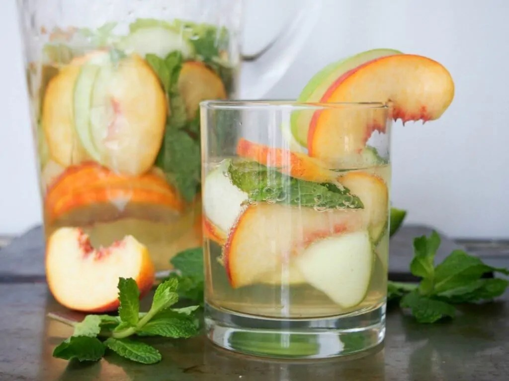white sangria with whiskey, apple and peach