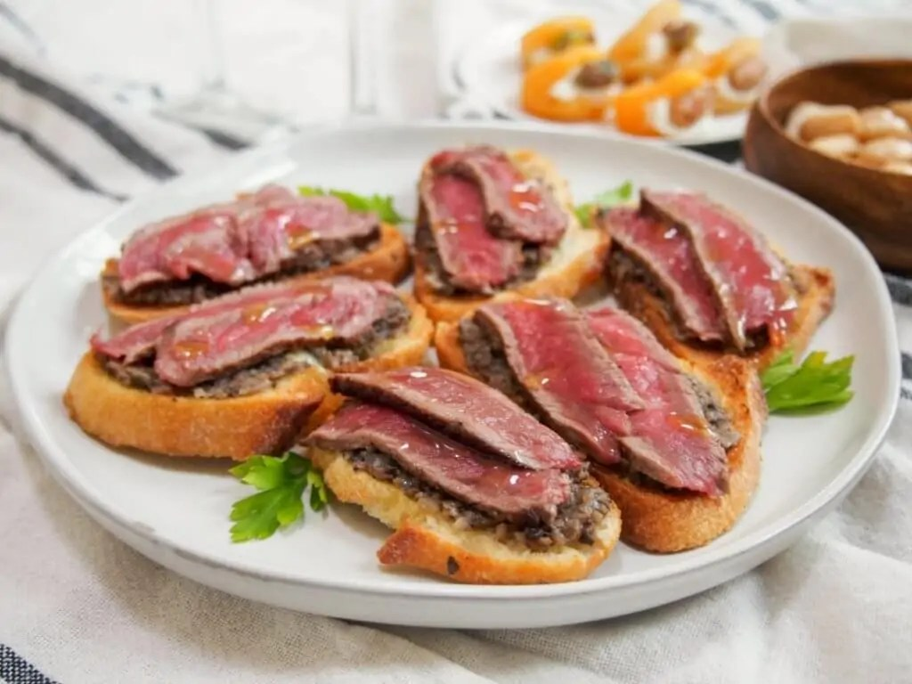 Steak crostini with mushroom pate and truffle oil