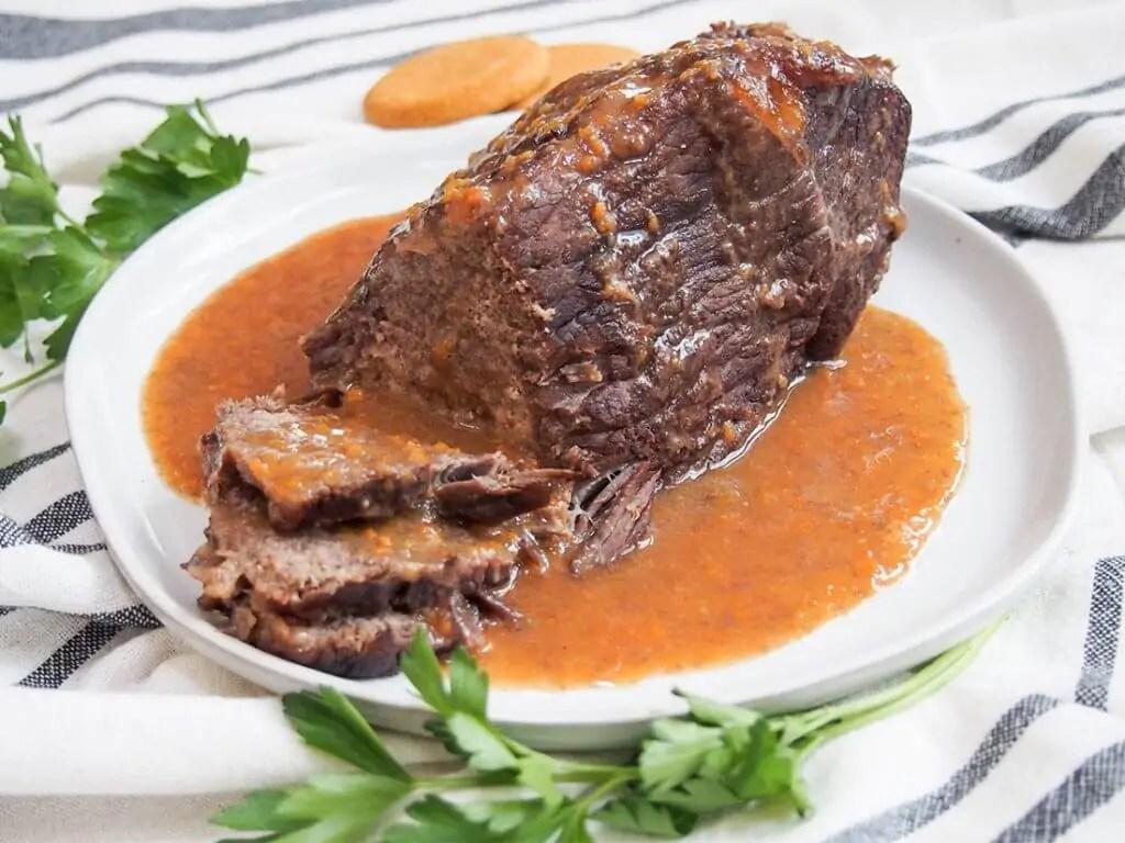 sauerbraten German pot roast on plate with sauce